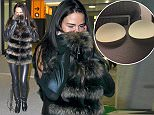*** Not available for subscription clients until after 22.00 on 281114 *** EXCLUSIVE ALLROUNDERKatie Price arrives at Heathrow after having breast surgery in Belgium Featuring: Katie Price, Jordan Where: London, United Kingdom When: 27 Nov 2014 Credit: WENN.com
