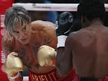 epa04507411 US actor and boxer Mickey Rourke 62 year old (L) fights with 29 year old US boxer Elliot Seymour during their bout in Moscow, Russia, 28 November 2014.  EPA/YURI KOCHETKOV