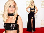 Singer Rita Ora poses for photographers at The British Fashion Awards 2014, in London, Monday, Dec. 1, 2014. (Photo by Jonathan Short/Invision/AP)