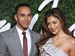 Formula One British driver Lewis Hamilton and his girlfriend US musician Nicole Scherzinger pose for pictures on the red carpet upon arrival to attend the British Fashion Awards 2014 in London on December 1, 2014. AFP PHOTO/JUSTIN TALLISJUSTIN TALLIS/AFP/Getty Images