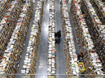 "FILE - In this Dec. 2, 2013, file photo, Amazon.com employees work the shelves along the miles of aisles at an Amazon.com Fulfillment Center on ""Cyber Monday"", the Monday after Thanksgiving and the busiest online shopping day of the holiday season, in Phoenix. Millions of Americans are expected to log on and keep shopping on Monday, Dec. 1, 2014, the day dubbed Cyber Monday. (AP Photo/Ross D. Franklin, File)"