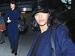 Rihanna makes a surprise visit to London arriving in the cold at Heathrow airport. Featuring: Rihanna Where: London, United Kingdom When: 01 Dec 2014 Credit: WENN.com