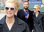 Tilda Swinton and Sandro Kopp share a laugh as they go for a walk in the East Village, NYC, heading to a local spa for a massage.\n\nPictured: Tilda Swinton, Sandro Kopp\nRef: SPL900666  301114  \nPicture by: Splash News\n\nSplash News and Pictures\nLos Angeles: 310-821-2666\nNew York: 212-619-2666\nLondon: 870-934-2666\nphotodesk@splashnews.com\n