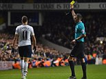 Tottenham Hotspur's Argentinian midfielder Erik Lamela (L) receives a yellow card from referee Michael Oliver during the English Premier League football match between Tottenham Hotspur and Everton at White Hart Lane in north London on November 30, 2014.  AFP PHOTO / BEN STANSALL RESTRICTED TO EDITORIAL USE. No use with unauthorized audio, video, data, fixture lists, club/league logos or live services. Online in-match use limited to 45 images, no video emulation. No use in betting, games or single club/league/player publications.BEN STANSALL/AFP/Getty Images