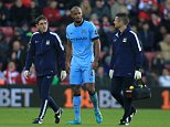 Manchester City's Vincent Kompany walks off the pitch with an injury during the Barclays Premier League match at St Mary's Stadium, Southampton. PRESS ASSOCIATION Photo. Picture date: Sunday November 30, 2014. See PA story SOCCER Southampton. Photo credit should read Nick Potts/PA Wire. Editorial use only. Maximum 45 images during a match. No video emulation or promotion as 'live'. No use in games, competitions, merchandise, betting or single club/player services. No use with unofficial audio, video, data, fixtures or club/league logos.