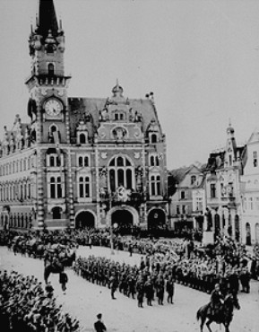 In the aftermath of the Munich agreement, which turned the Sudetenland of Czechoslovakia over to Germany, German troops march into the town square of Friedland. October 3, 1938.