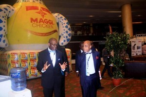 George Noah and CEO Troyka Holdings Mr. Biodun Shobanjo on a tour during the exhibition. Photo credit: #ASE2014