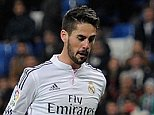 MADRID, SPAIN - DECEMBER 02:  Isco of Real Madrid CF lobs the ball over Inigo Romera to score Real's 2nd goal during the Copa Del Rey Round of 32, Second Leg match between Real Madrid CF and Cornella at Santiago Bernabeu stadium on December 2, 2014 in Madrid, Spain.  (Photo by Denis Doyle/Getty Images)