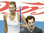 epa04507046 Andy Murray of Great Britain (L) and Maria Sharapova of Russia (R) celebrate a point against Nenad Zimonjic of Serbia and Kristina Mladenovic of France (unseen) during their mixed doubles match at the first leg of International Tennis Premier League (IPTL) at the Mall of Asia Arena in Pasay city, south of Manila, Philippines, 28  November 2014. The IPTL, a hybrid mix of current and former men's and women's players with a few legends tossed into the pool, also fields squads in India, Singapore and Dubai. The Manila weekend is billed as the biggest tennis event in the country since a 1989 exhibition between Bjorn Borg and John McEnroe.  EPA/DENNIS M. SABANGAN