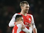 Per Mertesacker  of Arsenal and Alexis Sanchez of Arsenal celebrate after the final whistle