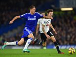 LONDON, ENGLAND - DECEMBER 03:  Nemanja Matic of Chelsea and Ryan Mason of Spurs battle for the ball during the Barclays Premier League match between Chelsea and Tottenham Hotspur at Stamford Bridge on December 3, 2014 in London, England.  (Photo by Shaun Botterill/Getty Images)