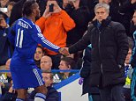 """Chelsea's Portuguese manager Jose Mourinho (R) shakes hands with Ivorian striker Didier Drogba (L) after he is substituted during the English Premier League football match between Chelsea and Tottenham Hotspur at Stamford Bridge in London on December 3, 2014. Chelsea won the game 3-0. AFP PHOTO/GLYN KIRK RESTRICTED TO EDITORIAL USE. NO USE WITH UNAUTHORIZED AUDIO, VIDEO, DATA, FIXTURE LISTS, CLUB/LEAGUE LOGOS OR """"LIVE"""" SERVICES. ONLINE IN-MATCH USE LIMITED TO 45 IMAGES, NO VIDEO EMULATION. NO USE IN BETTING, GAMES OR SINGLE CLUB/LEAGUE/PLAYER PUBLICATIONS.GLYN KIRK/AFP/Getty Images"""