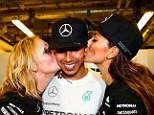 Hamilton was all smiles when celebrateing with his stepmother Linda Hamilton (left) and girlfriend Scherzinger