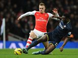 LONDON, ENGLAND - DECEMBER 03:  Calum Chambers of Arsenal challenges Victor Wanyama of Southampton during the match between Arsenal and Southampton in the Barclays Premier League at Emirates Stadium on December 3, 2014 in London, England.  (Photo by David Price/Arsenal FC via Getty Images)