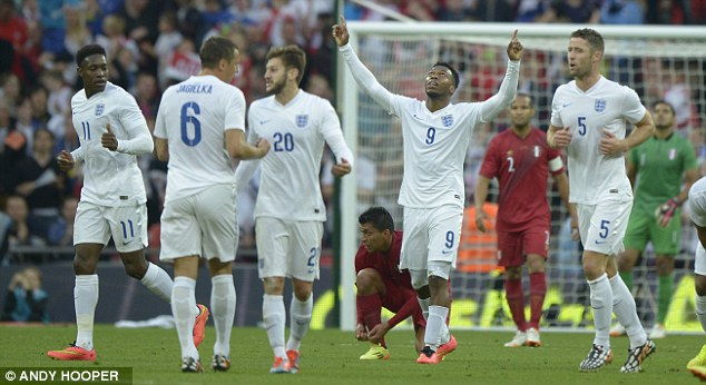 He's electric: Daniel Sturridge (second right) celebrates scoring for England against Peru last month