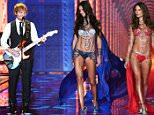 Strict embargo, not to be used before 21:00 GMT 02 Dec 2014 - Editorial Use Only, No Merchandising  Mandatory Credit: Photo by David Fisher/REX (4273353bp)  Adriana Lima and Alessandra Ambrosio on the catwalk with Ed Sheeran performing  Victoria's Secret Fashion Show, London, Britain - 02 Dec 2014