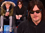 NEW YORK, NY - DECEMBER 02:  Norman Reedus and Mingus Reedus (L) attend Brooklyn Nets vs New York Knicks at Madison Square Garden on December 2, 2014 in New York City.  (Photo by James Devaney/GC Images)
