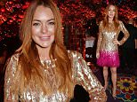 LONDON, ENGLAND - DECEMBER 02:  Lindsay Lohan attends the Chopard Christmas Party at Annabel's on December 2, 2014 in London, England.   Pic Credit: Dave Benett