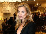 "PARIS, FRANCE - DECEMBER 04:  Model Kate Moss attends the Longchamp Elysees ""Lights On Party"" Boutique Launch on December 4, 2014 in Paris, France.  (Photo by Bertrand Rindoff Petroff/French Select/Getty Images)"