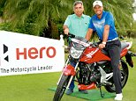 RPT..Orlando: Pawan Munjal, VC & MD, HeroMotocorp with golfer Tiger Woods who was announced as the new brand ambassador of the company in Orlando on Tuesday. PTI Photo (PTI12_3_2014_000057A)