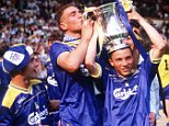 F.A. Cup Final, Wembley, 14th May 1988, Liverpool 0 v Wimbledon 1, Wimbledon's Vinnie Jones kisses the cup which is held by Terry Phelan, as Dennis Wise looks on  (Photo by Bob Thomas/Getty Images)