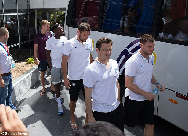 Afternoon out: The England squad board the team coach ahead of an afternoon of shopping in Manaus