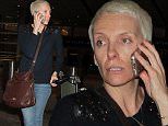 Australian actress Toni Collette is spotted chatting on her cellphone as she arrives at LAX Airport in Los Angeles, Ca\n\nPictured: Toni Collette\nRef: SPL904307  031214  \nPicture by: Chessa /London Entertainment\n\nSplash News and Pictures\nLos Angeles: 310-821-2666\nNew York: 212-619-2666\nLondon: 870-934-2666\nphotodesk@splashnews.com\n