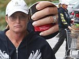 Please contact X17 before any use of these exclusive photos - x17@x17agency.com   Sad Bruce Jenner folloing in the footsteps of his step daughters with lip injections and Botox with diamond earrings signature ponytail, French  manicure and a darker tan. He's wearing no shirt under his zip up hoodie. He stops by Starbucks and picks up some groceries that include corn chips before going home. \nDecember 3, 2014 X17online.com
