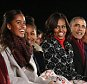 U.S. President Barack Obama and his family, daughters Malia (L) and Sasha (2nd L), first lady Michelle Obama (C) and mother-in-law Marian Robinson (R), attend the lighting of the National Christmas Tree on the Ellipse near the White House in Washington, December 4, 2014.       REUTERS/Larry Downing   (UNITED STATES - Tags: POLITICS ENTERTAINMENT SOCIETY)