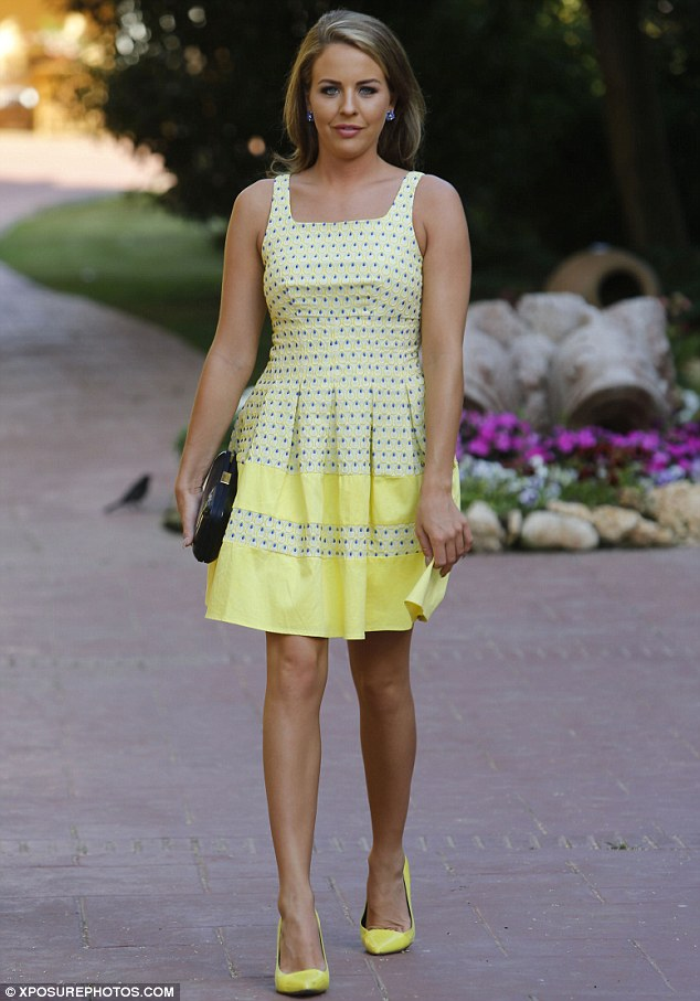 Demure: Lydia Bright ditched the figure-hugging looks for an elegant yellow dress in Marbella on Thursday