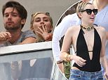 Picture Shows: Patrick Schwarzenegger, Miley Cyrus  December 04, 2014\n \n New couple Miley Cyrus and Patrick Schwarzenegger are spotted smoking some funny looking cigarettes on their hotel balcony in Miami, Florida. Patrick's conservative mom is reportedly worried about Miley's wild ways and her influence on the 21-year-old Schwarzenegger. \n \n Non-Exclusive\n UK RIGHTS ONLY\n \n Pictures by : FameFlynet UK © 2014\n Tel : +44 (0)20 3551 5049\n Email : info@fameflynet.uk.com