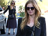 December 4, 2014: Isla Fisher chats on speaker cell phone while driving in Los Angeles, CA. Mandatory Credit: Chiva/INFphoto.com Ref.: infusla-275