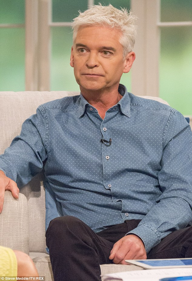 Dangers: Phillip Schofield, pictured this week presenting on This Morning, has revealed that the 5.2 diet helped him shift a stone and a half but left him hallucinating