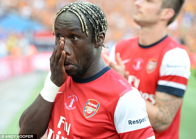 Tearful exit: Sagna's last game for Arsenal was in their 3-2 FA Cup final victory against Hull City in May