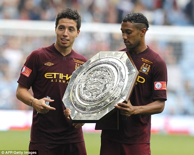 Reunited: Sagna will be joining former Arsenal duo Samir Nasri (left) and Gael Clichy (right) at City