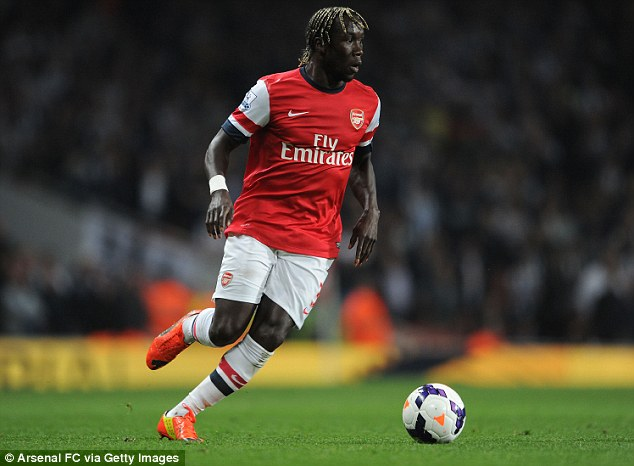 Done: Bacary Sagna (right) has joined Manchester City on a free transfer from Premier League rivals Arsenal