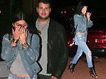 UK CLIENTS MUST CREDIT: AKM-GSI ONLY EXCLUSIVE: Calabasas, CA - Kylie Jenner buried her face in her hands when she was caught on a sushi dinner date with a new guy.  Kylie's companion did not appear to be as camera shy as he escorted her through the Sugarfish Sushi parking lot. The 17-year-old reality star showed off her midriff beneath a grey tee paired with a jean jacket, ripped jeans and Christian Louboutin leather lace up ankle boots.  Pictured: Kylie Jenner Ref: SPL905256  041214   EXCLUSIVE Picture by: AKM-GSI / Splash News