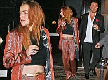 04.DECEMBER.2014 - LONDON - UK *** EXCLUSIVE ALL ROUND PICTURES *** AMERICAN ACTRESS LINDSAY LOHAN SPOTTED LEAVING TOY ROOM NIGHT CLUB WITH HER NEW MAN, LONDON NIGHT CLUB MAGNATE JORDAN ROCCA, IN MAYFAIR, LONDON, UK. THE PAIR WERE SEEN HOLDING HANDS. AFTER REALISING SHE WAS BEING PHOTOGRAPHED LOHAN RETURNED TO THE VENUE, REAPPEARING 5 MINUTES LATER HIDING UNDER A COAT AND GETTING INTO A WAITING CAR. BYLINE MUST READ : XPOSUREPHOTOS.COM ***UK CLIENTS - PICTURES CONTAINING CHILDREN PLEASE PIXELATE FACE PRIOR TO PUBLICATION *** *UK CLIENTS MUST CALL PRIOR TO TV OR ONLINE USAGE PLEASE TELEPHONE 0208 344 2007*