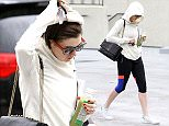 UK CLIENTS MUST CREDIT: AKM-GSI ONLY EXCLUSIVE: **SHOT ON 12/3/14** Anne Hathaway throws her hoodie over her head to take cover from the rain after visiting her gym for a workout in Los Angeles. Despite the gloomy weather, Anne got herself motivated to get out of the house for some exercise.  Pictured: Anne Hathaway Ref: SPL904789  041214   EXCLUSIVE Picture by: AKM-GSI / Splash News