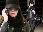 *EXCLUSIVE* Los Angeles, CA - Up-and-coming modeling star Kendall Jenner returned to L.A. from Europe on Wednesday afternoon, keeping a low profile at the airport. The reality TV starlet attended the British Fashion Awards with model bestie Cara Delevingne on Monday night before the two jetted off to Austria to walk in the Chanel Metiers d'Art show. Kendall looked chic and simple in an all-black ensemble, covering her face behind a black baseball cap and oversized sunglasses.\n AKM-GSI                   December 3, 2014\n To License These Photos, Please Contact :\n \n Steve Ginsburg\n (310) 505-8447\n (323) 423-9397\n steve@akmgsi.com\n sales@akmgsi.com\n \n or\n \n Maria Buda\n (917) 242-1505\n mbuda@akmgsi.com\n ginsburgspalyinc@gmail.com