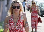 EXCLUSIVE: Actress Kate Hudson shows off her toned arms in a strapless red sundress while getting coffee in Miami Beach, FL. She was seen texting on her iPhone while enjoying the warm Miami weather.  Pictured: Kate Hudson Ref: SPL903206  031214   EXCLUSIVE Picture by: Pichichi / Splash News  Splash News and Pictures Los Angeles: 310-821-2666 New York: 212-619-2666 London: 870-934-2666 photodesk@splashnews.com