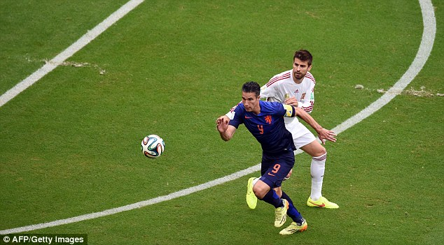 Chase: Van Persie runs after the ball in front of Spain's Gerard Pique during their Group B clash