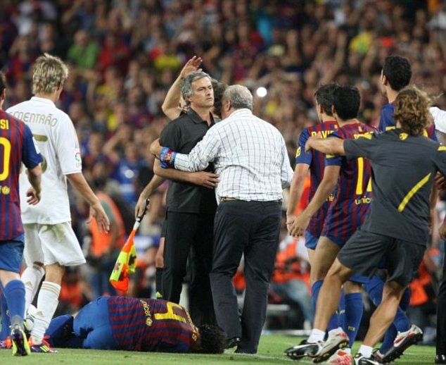 Did Jose kick him? Barca players rush to confront Mourinho while Fabregas lies prostrate on the pitch