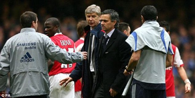 Best of enemies: Wenger and Mourinho have had a bitter rivalry ever since the Portuguese came to England