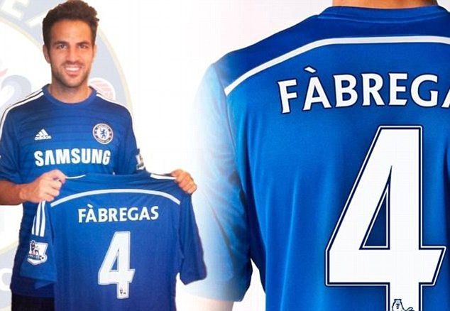 Close your eyes, Arsenal fans: Cesc Fabregas poses with his new Chelsea shirt after signing for £30m