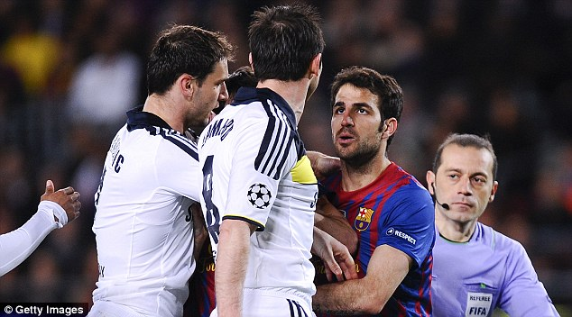 Feud: Fabregas (right) has had several run-ins with Chelsea's players in the past