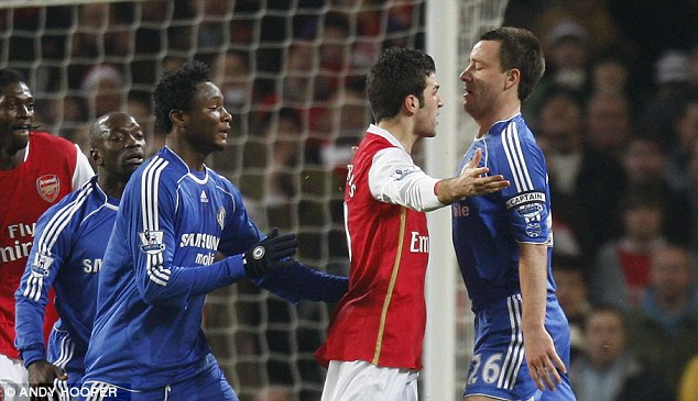 Team-mates: John Terry (right) squares up to Fabregas during a Premier League match in 2007