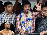 Philippine boxing champion Manny Pacquiao (C) waves to his fans during his victory parade in Manila on November 27, 2014. Pacquiao comprehensively dismantled Chris Algieri to retain his World Boxing Organization welterweight title at the Cotai Arena in Macau on November 23.  AFP PHOTO/NOEL CELISNOEL CELIS/AFP/Getty Images