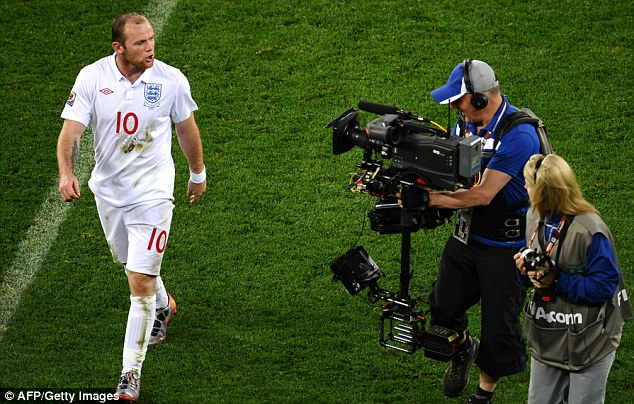 Low points: Rooney has not had a great time at World Cups, raging into a TV camera against Algeria in 2010 and (below) being sent off against Portugal in 2006