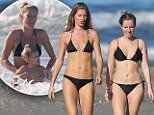 129877, PREMIUM EXCLUSIVE: Gisele Bundchen and her younger sister Rafaela take a bikini clad stroll on the beach while on vacation in Costa Rica. The top-earning supermodel could be seen touching her armpit and appeared to adjust the straps on her bikini top as she shared a laugh with her sister in the sand. Gisele was enjoying a trip with family in the tropical paradise. Costa Rica - Wednesday December 3, 2014. Photograph: © PacificCoastNews. Los Angeles Office: +1 310.822.0419 sales@pacificcoastnews.com FEE MUST BE AGREED PRIOR TO USAGE